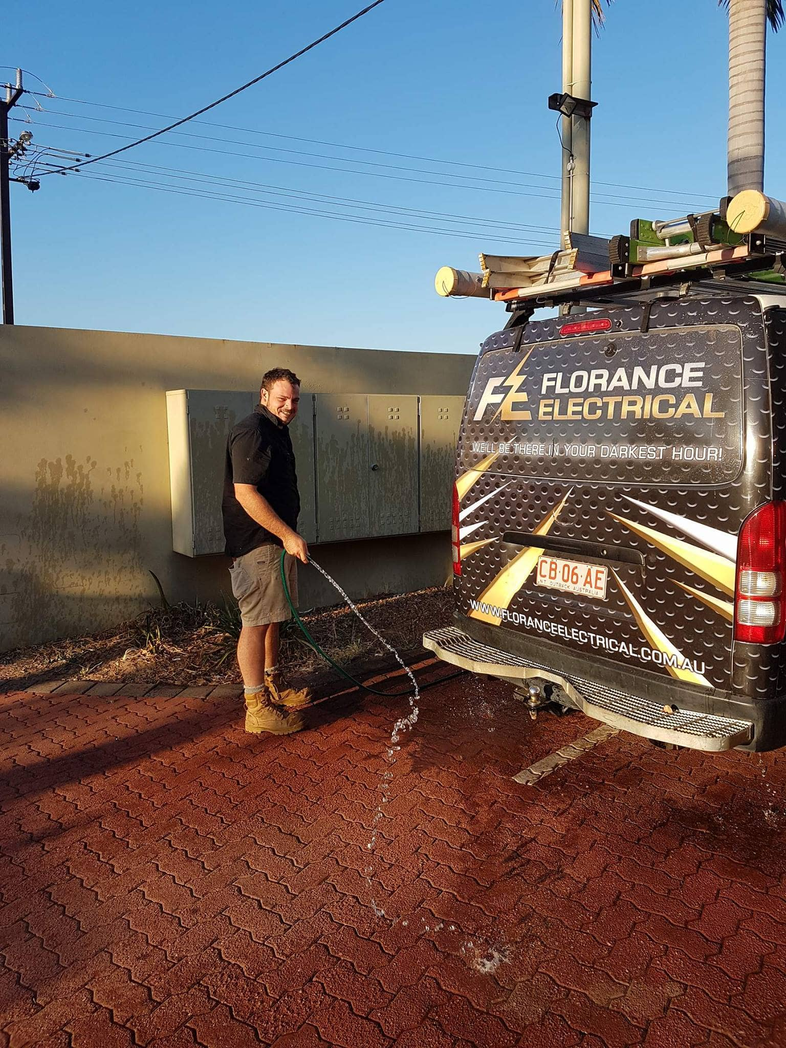 electrician washing a hiace van