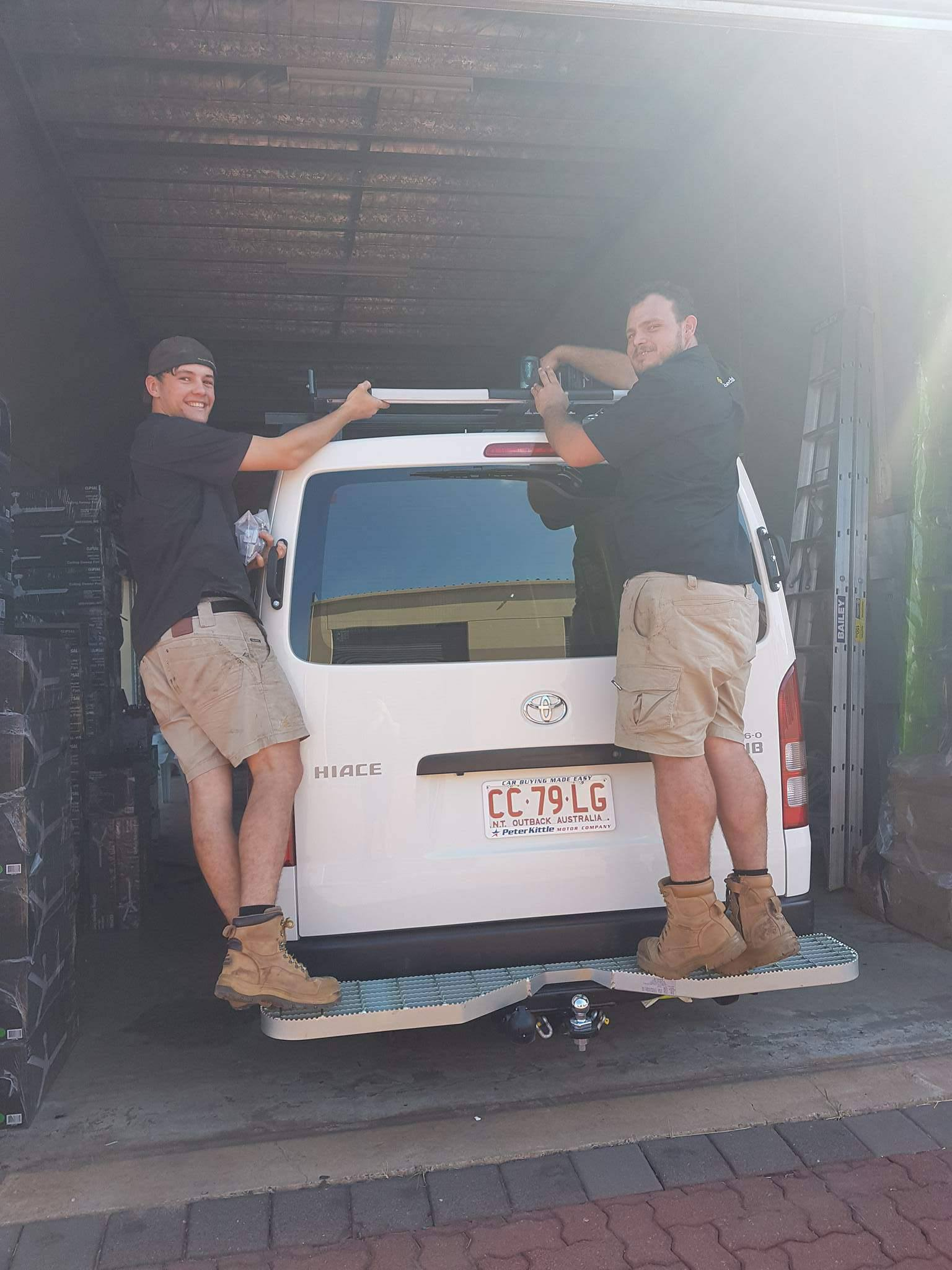 Tate & Alex on the rear step of a Hiace van