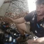 An electrician sitting next to a faulty pool pump